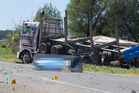 A piece from one of the trucks sits on the road at the scene of the fatal truck crash in the eastern Bay of Plenty. Photo / Alan Gibson