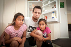 Shane Hill with his daughters Cayleh, 10, and Savanah, 7  in their Papamoa home which was broken into and only food stolen. PHOTO/ANDREW