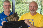 Rotary Rotorua Sunrise member Mike Bannister (left) and Rotorua Charity Luncheon event organiser Don Gollan with the limited edition All Blacks jersey signed by McCaw. ​Photo/Stephen Parker