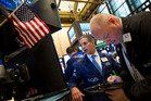 Traders work on the floor of the New York Stock Exchange. Photo / AP