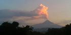 Measuring the ratio of gas to carbon around volcanoes could help predict when they will erupt. Photo / AP