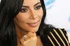 Kim Kardashian is suffering from flashbacks from the night she was tied up and robbed at gun point. Photo / AP