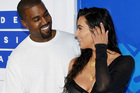 Kanye West and Kim Kardashian West arrive at the MTV Video Music Awards in New York in August, with Kim flashing her diamond engagement ring, which was stolen. Photo / AP