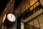 A clock sits outside of Trump Tower at midnight. Photo / AP