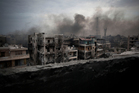 Smoke rises over Saif Al Dawla district, in Aleppo, Syria. There have been attempts at ceasefires, but none have held. Photo / AP