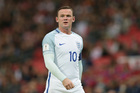 Wayne Rooney's wife took to social media in defence of the England captain after he was booed by fans. Photo / AP.