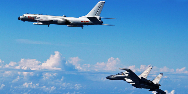 Photo released by Xinhua News Agency, Chinese People's Liberation Army Air Force Su-30 fighter, right, flies along with a H-6K bomber. Photo / AP