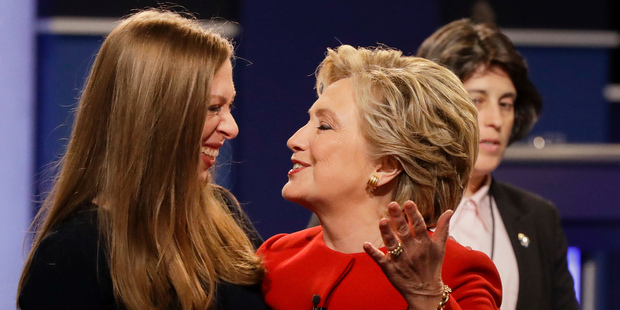 Democratic presidential nominee Hillary Clinton talks with Chelsea Clinton, daughter of Hillary Clinton after the presidential debate. Photo / AP