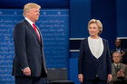 Hillary Clinton tried to convey her vision of a united nation while Donald Trump spent time attacking Clinton's husband, former President Bill Clinton. Photo / AP