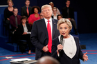 Democratic presidential nominee Hillary Clinton, right, speaks as Republican presidential nominee Donald Trump listens during the second presidential debate. Photo / Getty Images