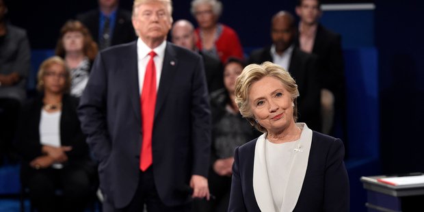 Loading Donald Trump and Hillary Clinton battle it out in the second 2016 presidential debate. Photo / AP