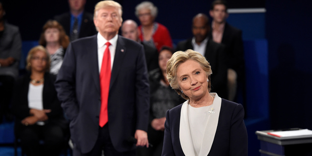 Trump stalked Clinton around the stage. Photo / AP