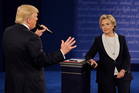 Democratic presidential nominee Hillary Clinton listens to Republican presidential nominee Donald Trump during the second presidential debate at Washington University. Photo / AP