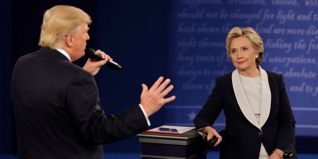 Loading Democratic presidential nominee Hillary Clinton listens to Republican presidential nominee Donald Trump during the second presidential debate at Washington University. Photo / AP