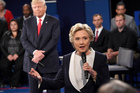 Democratic presidential nominee Hillary Clinton speaks as Republican presidential nominee Donald Trump reacts during the second presidential debate. Photo / AP