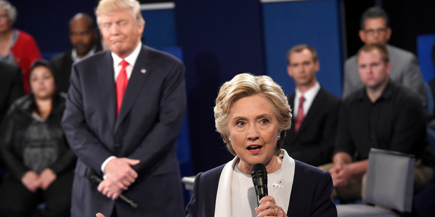 Democratic presidential nominee Hillary Clinton speaks as Republican presidential nominee Donald Trump reacts. Photo / AP