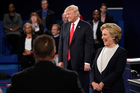 Donald Trump and Hillary Clinton react to a question during the second presidential debate. Photo / AP