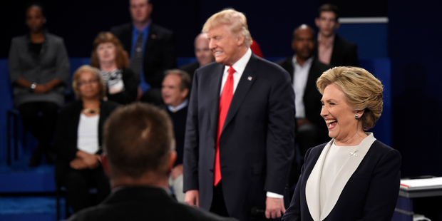 Republican presidential nominee Donald Trump and Democratic presidential nominee Hillary Clinton reacts to a question during the second presidential debate. Photo / AP