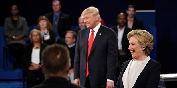 Donald Trump and Hillary Clinton reacts to a question during the second presidential debate at Washington University. Photo / AP