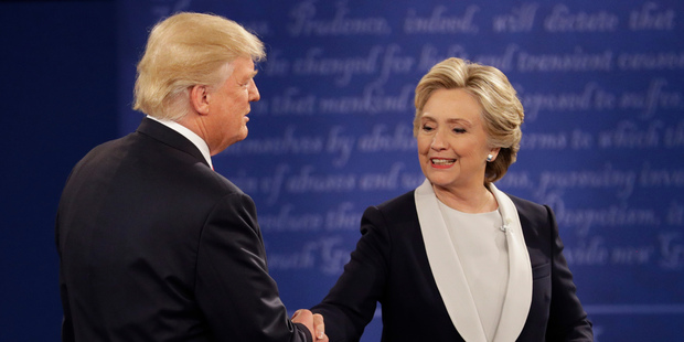 Loading Republican presidential nominee Donald Trump and Democratic presidential nominee Hillary Clinton shake hands following the second presidential debate. Photo / AP