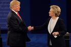 Republican presidential nominee Donald Trump shakes hands with Democratic presidential nominee Hillary Clinton following the second presidential debate. Photo / AP