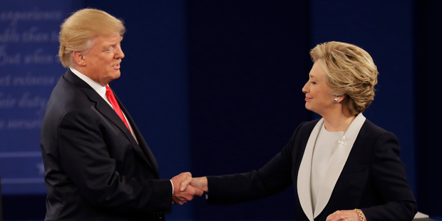 Loading Republican presidential nominee Donald Trump shakes hands with Democratic presidential nominee Hillary Clinton following the second presidential debate. Photo / AP