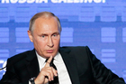 Russian President Vladimir Putin wants Russians to reutn home. Photo / AP