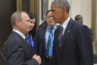 Russian President Vladimir Putin, left, speaks with U.S. President Barack Obama in Hangzhou in eastern China's Zhejiang province. Photo / AP