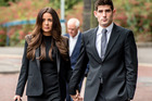 Football player Ched Evans, right, and his partner Natasha Massey arrive at Cardiff Crown Court, in Cardiff, Friday, Oct. 14, 2016. Photo / AP.