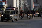 Pakistani police officers patrol ahead of Ashura, the tenth day of the Islamic month of Muharram. Photo / AP