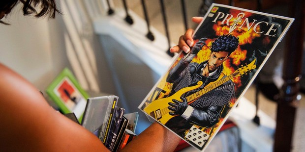 Margo Davis holds a Prince comic book she collected at her home. Photo / AP