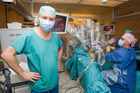 A surgeon performs an operation with the help of robot da Vinci at the University Hospital Geneva. Photo / AP