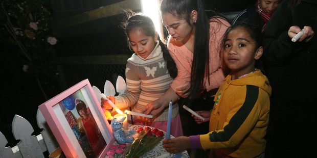 Friends of 4-year-old Maggie gather outside her home on Moana Ave. Photo / Greg Bowker
