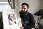 Brett Morrison holding a picture of his late wife, Sarah. Photo/file