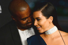 Kim Kardashian, pictured with her husband Kanye West, is well-known for displaying her considerable wealth in public. Photo/AP