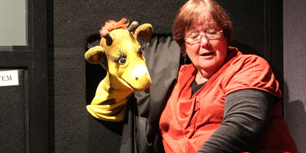 Little Harold the giraffe and Anne Jamieson, educator, Life Education Trust Hawke's Bay, and kids at Frimley School, Hastings 21 October 2014 ADFEAT Hawke's Bay Today Photograph by Duncan Brown.