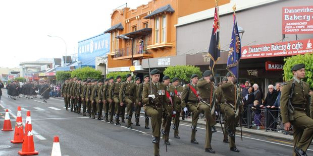 The 1st Battalion Royal New Zealand Infantry Regiment, accompanied by the Dannevirke Highland Pipe Band.