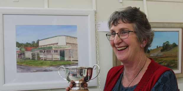 DELIGHTED: Artist Ann Berry was the winner of the Rosebowl for her depiction of a historic Pongaroa building which burned down last year. PHOTO/CHRISTINE McKAY