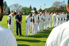 Premier club cricketers observe a minute's silence for CHB stalwart Mike Lewis before the start of their season at Nelson Park, Napier, on Saturday. PHOTO/Warren Buckland