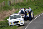 Police inspect a roadside near where a man was fatally shot in Mohaka yesterday. Photo / Paul Taylor