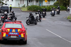 Police kept a close eye on the contingent of motorcycle gang members as they headed North after a blessing of the site on William Jones Drive. Photo/John Stone