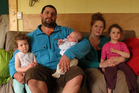 Noah Wakelam at home with his wife Debby and children Evelyn, 2, Vaun, 6 weeks, and Lydia, 3. PHOTO / PETER DE GRAAF