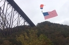 Dr Erik Monasterio filmed this footage showing participant hitting a tree and falling to the ground at the 2014 New River Gorge Bridge Day BASE Jumping event in West Virginia, USA.