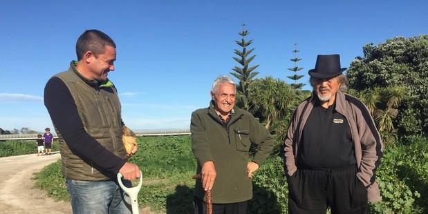 SYMBOLIC: : Piripi Smith (holding the mauri stone) and kaumatua Matiu Eru of Te Matau a Māui Voyaging Trust with Dan Gilbert at today's ceremony. PHOTO/SUPPLIED