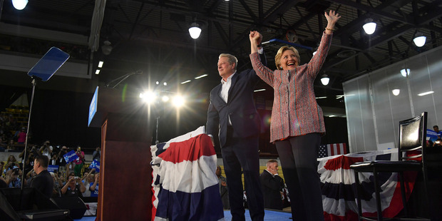 Democratic presidential candidate Hillary Clinton and former Vice-President Al Gore wave to supporters following a rally at Miami Dade College in Miami. Photo / Washington Post