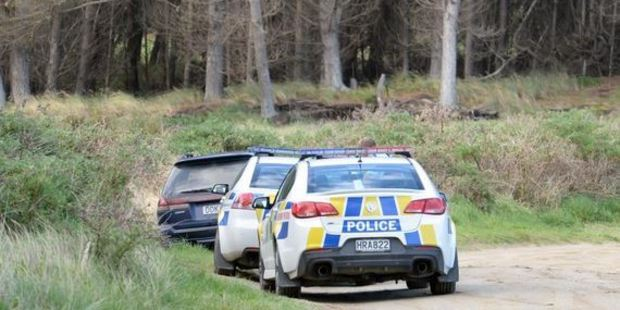 Two police cars are parked beside this Subaru, at Waikouaiti, at the end of a 16-hour drama yesterday. Photo / ODT
