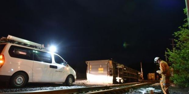 Part of a train track switching device was bent high in the air after the derailment.