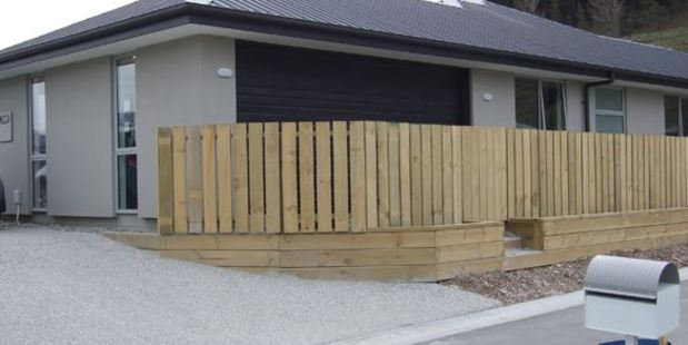 A new Shotover Country house has become a local curiosity after a fence sprung up in front of the garage. Photo: Scene.co.nz