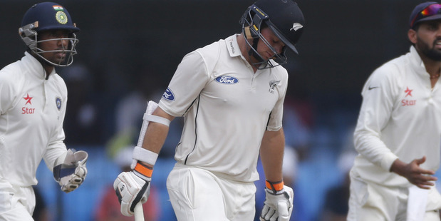 Loading Tom Latham walks back after out during the third day of the third test cricket match between India and New Zealand in Indore. Photo / AP