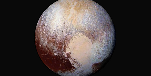 An exaggerated colour photo shows the varied terrain of Pluto, the most well-known dwarf planet. Photo / Nasa